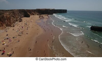 Aerial. Video filming on the beach Tonel. Sagres Portugal