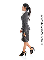 Business woman walking - Full length side view of African...