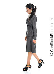 Side view Indian business woman walking - Full length side...