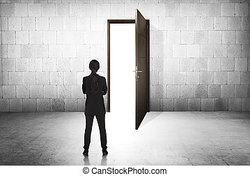 Business woman going to the open door. Career path...