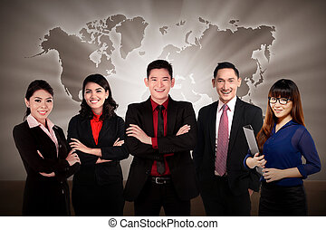 Global Business Team - Asian business team with world map...