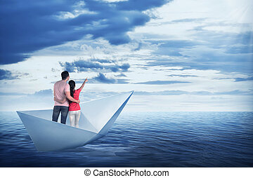 Asian couple on the paper boat