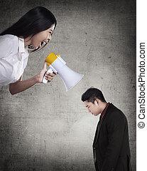 Business leader give order via megaphone to subordinate....