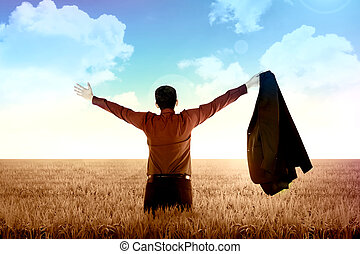Business Freedom Concept - Man open his suit, raise arms on...