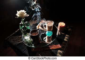 Evening coffee in a romantic atmosphere in dark colors. -...