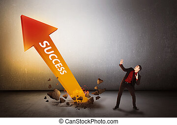 Asian business man surprise looking arrow of success out...