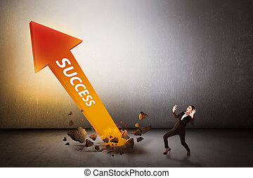 Asian business woman surprise looking arrow of success out...