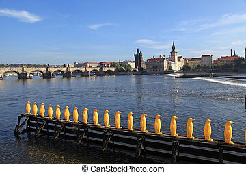 Yellow penguin statues by the Vltava river in Prague, Czech...