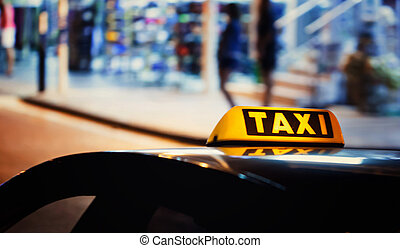 Taxi sign on the roof of a car - Taxi sign on the roof of a...