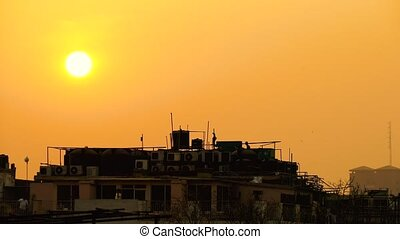 Beautiful Golden Sun Setting Over the Roofs of New Delhi. -...
