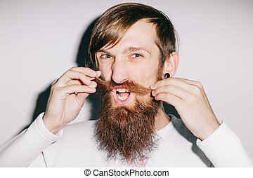 Man twirling his mustache making a face