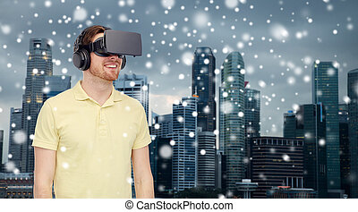 happy man in virtual reality headset or 3d glasses -...