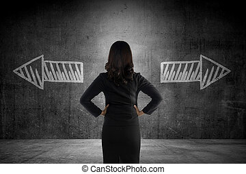 Business woman has to choose between two way. Business...