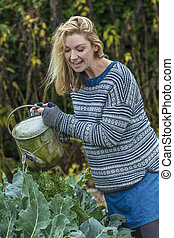 Middle Aged Woman Vegetable Gardening Watering Can