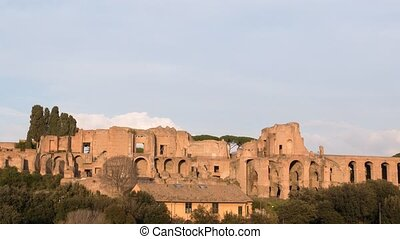 Ruins of Palatine hill palace in Rome. SunSet. Italy. Time...