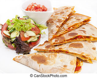 Mexican dish and a salad with vegetables