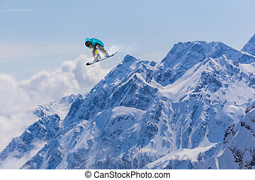 Flying snowboarder on mountains
