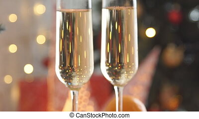 Champagne. Two Flutes with Sparkling Champagne over Holiday...