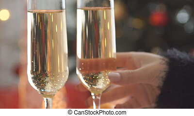 Champagne. Two Flutes with Sparkling Champagne over...