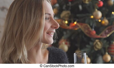 woman drinking champagne the Christmas