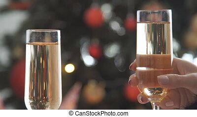 Champagne. Two Glases with Sparkling Champagne Toasting over...