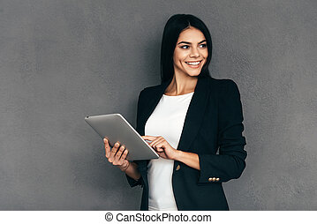Confident business expert. Attractive young woman in smart...