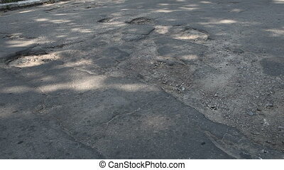 Pothole on the road - Potholes on the old highway in the...