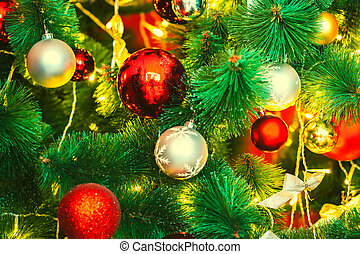 Beautiful decorated Christmas tree with red and goldish...