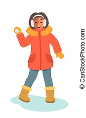 African girl in winter clothes throwing snowball