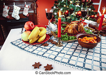 Christmas dinner by candlelight, table setting. Thanksgiving...