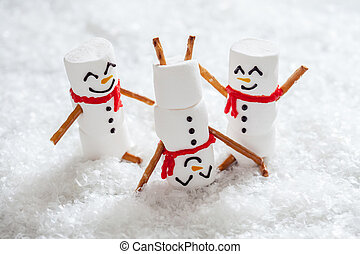 Happy funny marshmallow snowmans on snow - Happy funny...