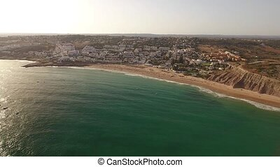 Aerial. Summertime at the beach bathing Luz. - Summertime at...