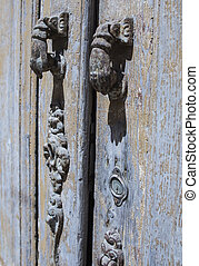 antique rusty lock in wooden door