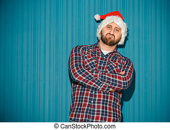 The opinionated christmas man wearing a santa hat on the...