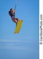 Wan riding kite surf on sea waves - Athletic man jump on...