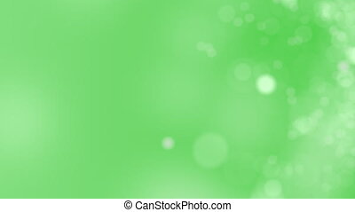 Green motion background. Abstract glowing bokeh circles or...