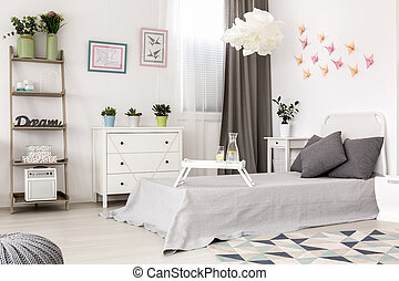 Bedroom with paper decoration on the wall.