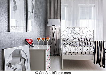Bedroom with metal frame bed