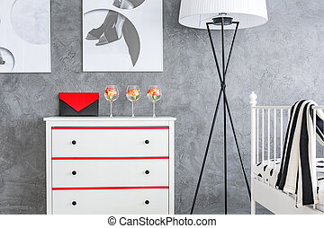 White dresser in grey room - White dresser and simple bed...