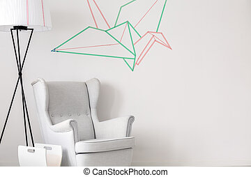 Design white armchair and lamp