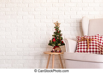 Little christmas tree and a couch