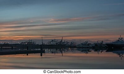 time-lapse Twilight in the port of Valencia cranes working...