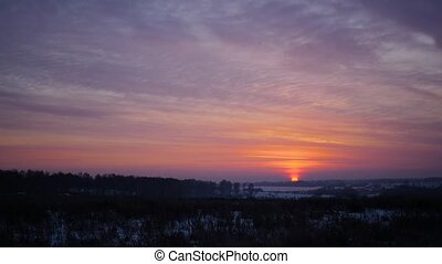 the sunset in cold winter day. red sky