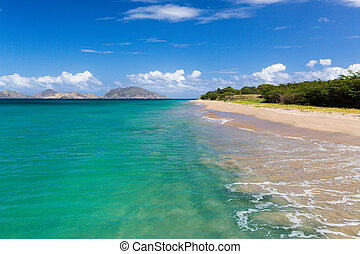 View from St Nevis towards St Kitts in the Caribbean beach...