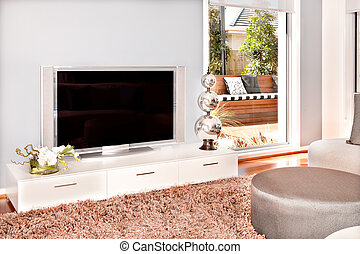 Closeup of a television in modern living room of a luxurious house