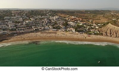 Aerial. Videography drone, town Luz and resting tourists....