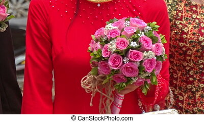 Closeup Girl in Red Holds Wedding Pink Rose Bouquet