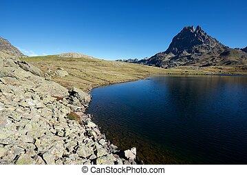 Pyrenees - Midi Dossau Peak reflected and Ayous lake. Ossau...