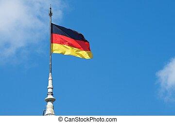 German national flag waving in the wind.