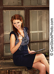 Pretty girl with clipboard and pen. - Beautiful girl with a...